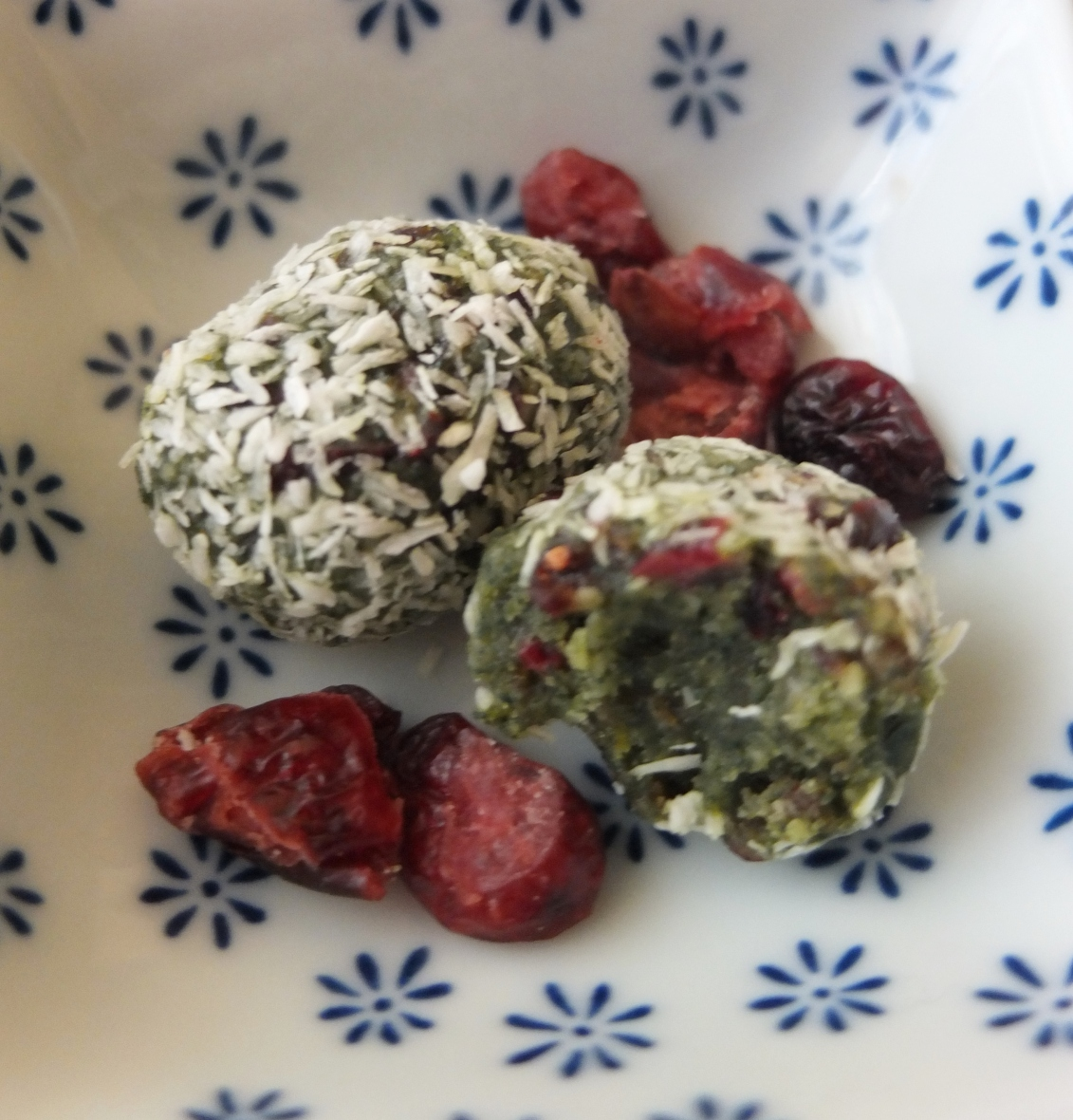 Spirulina date and cranberry bliss balls with matcha, ginger and orange zest