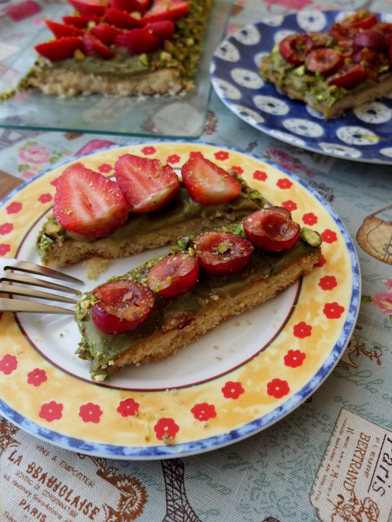 Slices of strawberry and pistachio tart