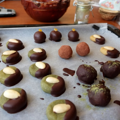 Covering the marzipans and caramels in chocolate