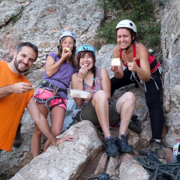 Climbers eating Japanese cheesecake at the rock