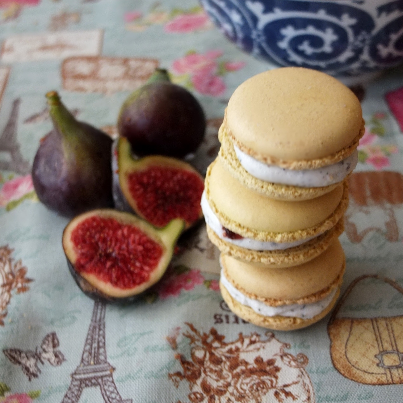 Goats' cheese macarons with fig, walnut and black sesame seeds