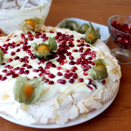 Pomegranate and passion fruit pavlova