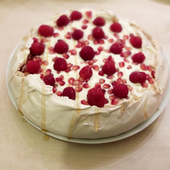 Passionfruit mousse and pomegranate pavlova, with raspberries
