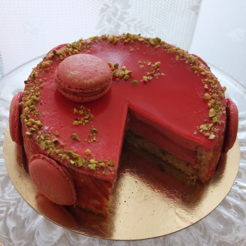 Very raspberry mousse cake with pistachios