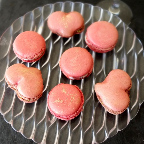 Raspberry curd, goats' cheese and black sesame macarons