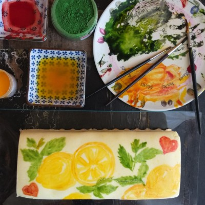 Painting a mojito lemon drizzle cake