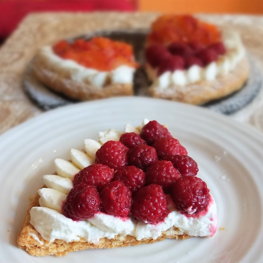 Fruit and cream puff pastry tart with frozen raspberries