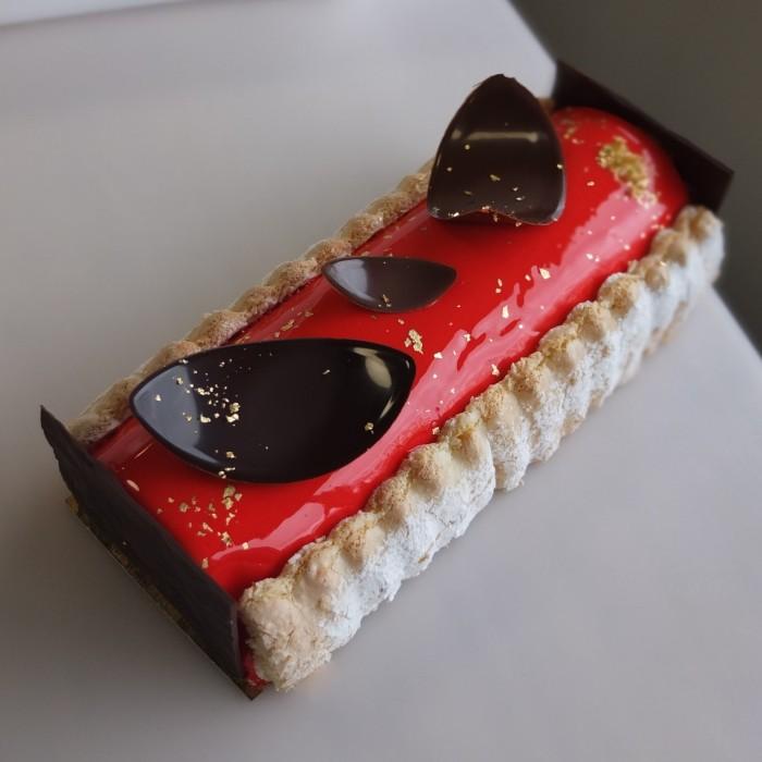 Passion fruit-raspberry yule log cake (bûche)