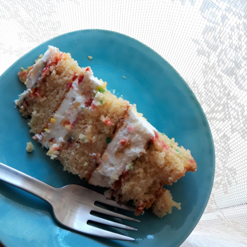 A slice of birthday layer cake