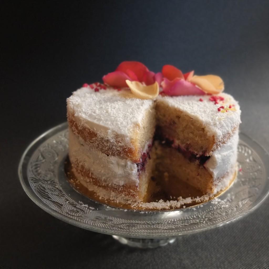 Healthier vegan raspberry, coconut and almond layer cake