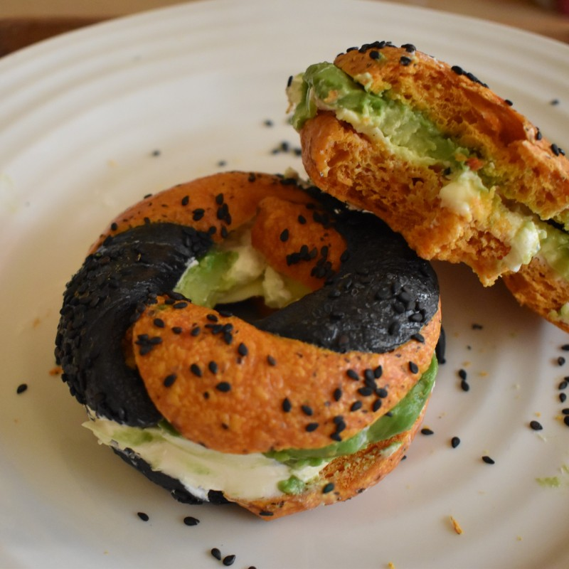 Turmeric and avocado sourdough bagels with cream cheese and avocado