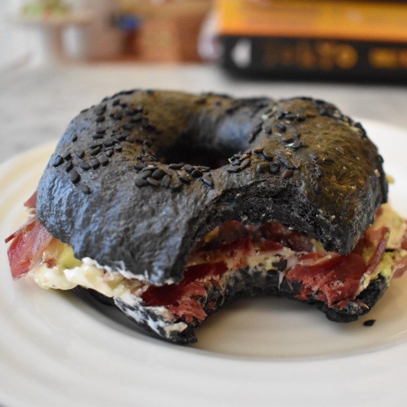 Activated charcoal sourdough bagel with cured ham