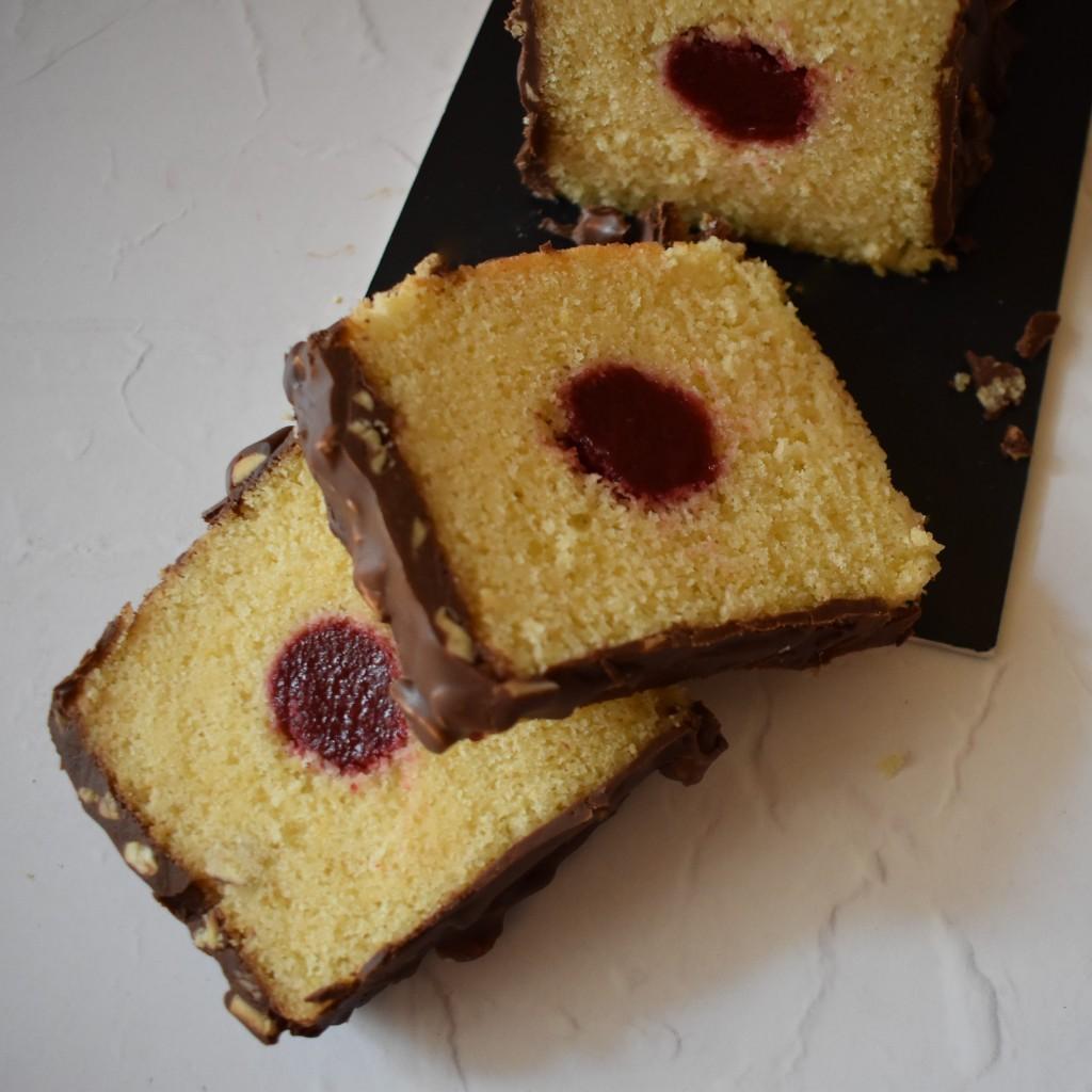 Holey Moley lemon surprise cake with raspbery insert and rocher chocolate glaçage