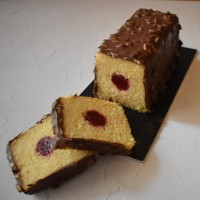 Holey Moley lemon loaf cake recipe!  Easy chocolate rocher glaze, optionally with raspberry insert, glutenfree and lower sugar!