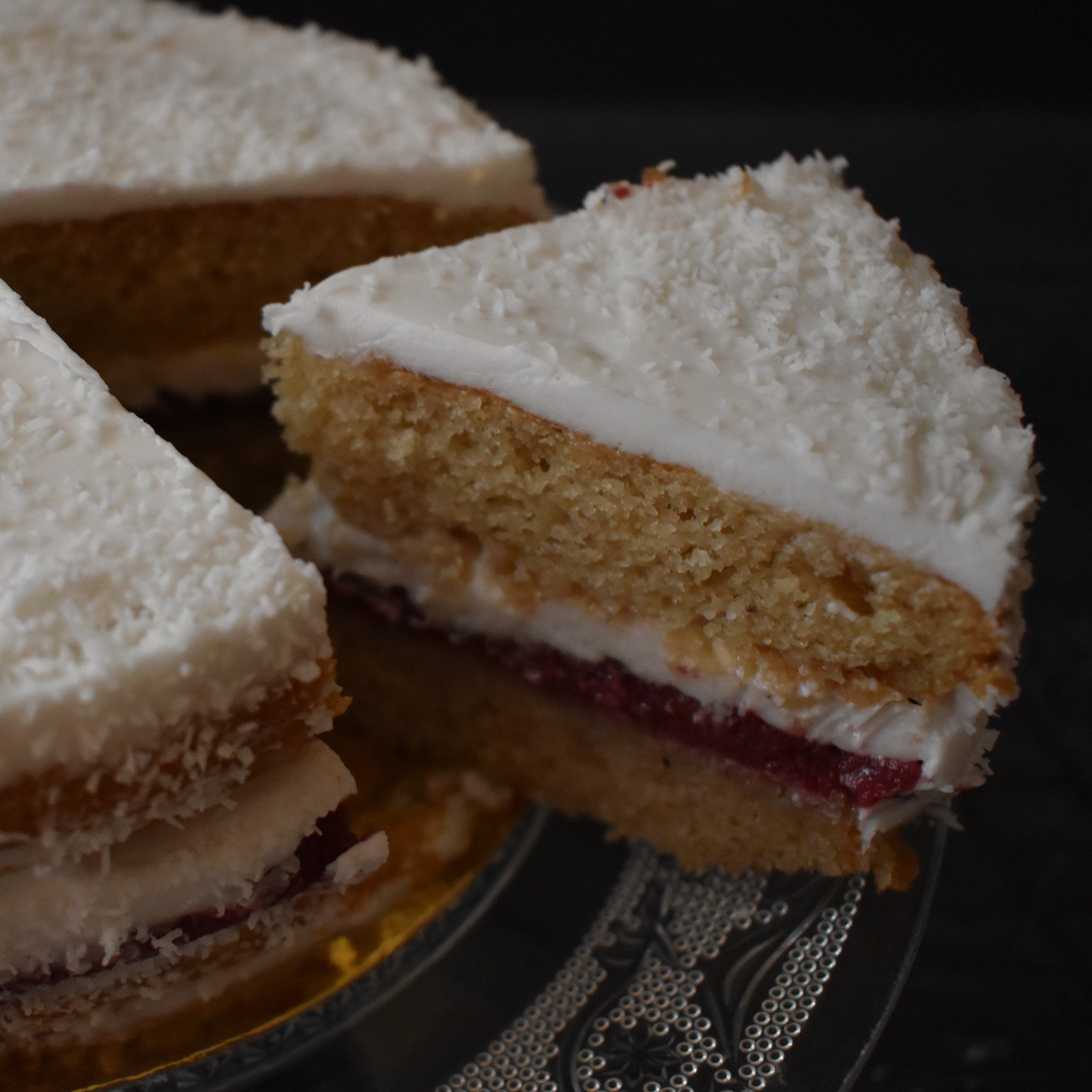 Snowy love vegan layer cake with blackcurrant curd and coconut buttercream